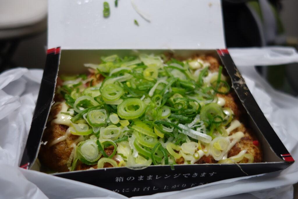 Takoyaki with diced green onions.