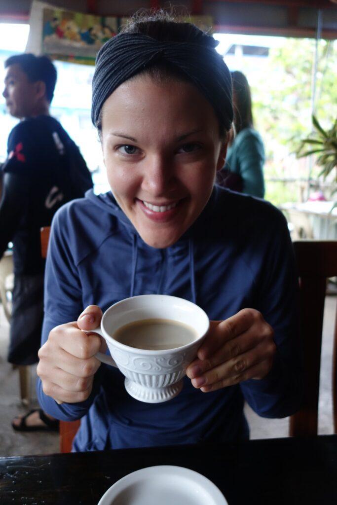 Enjoying civet coffee.