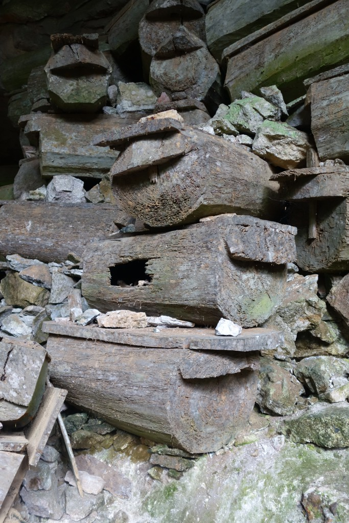 Coffins stacked in the entrance to the cave system.