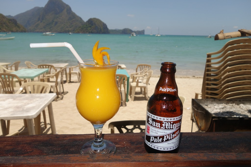 A mango smoothie and a San Miguel Pilsner on the beach in El Nido.