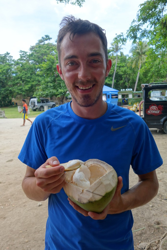 Eating the flesh of a young coconut.