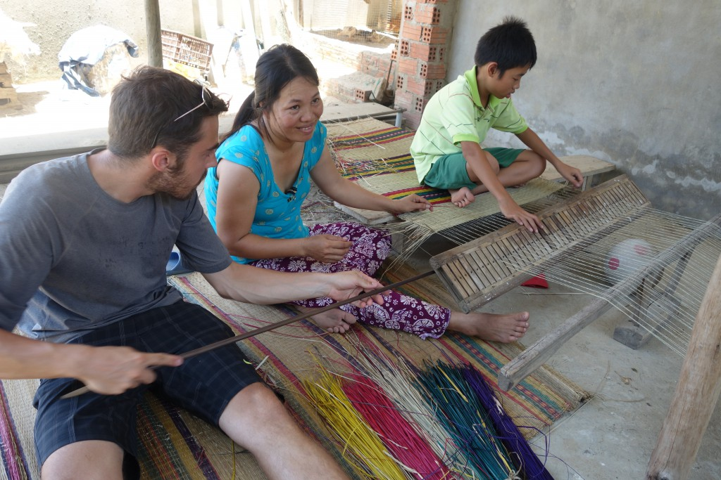 Jon learning how to weave straw mats.