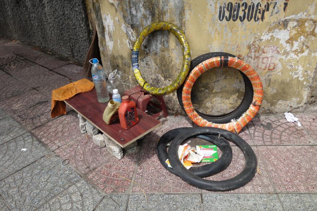 """A tire repair """"shop"""" in Saigon."""