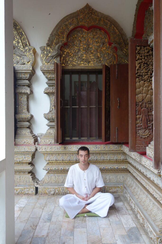 Jon demonstrating the sitting meditation pose.