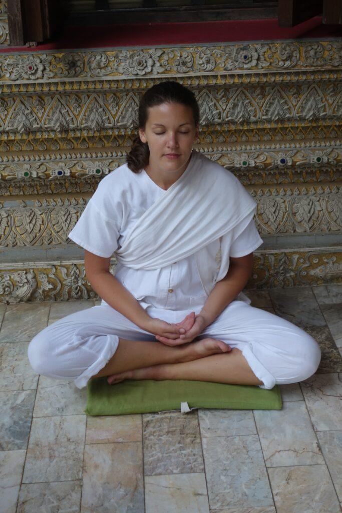Amy demonstrating sitting meditation.