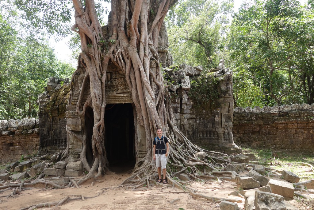 Jon in front of one of the temples covered with a strangler fig.