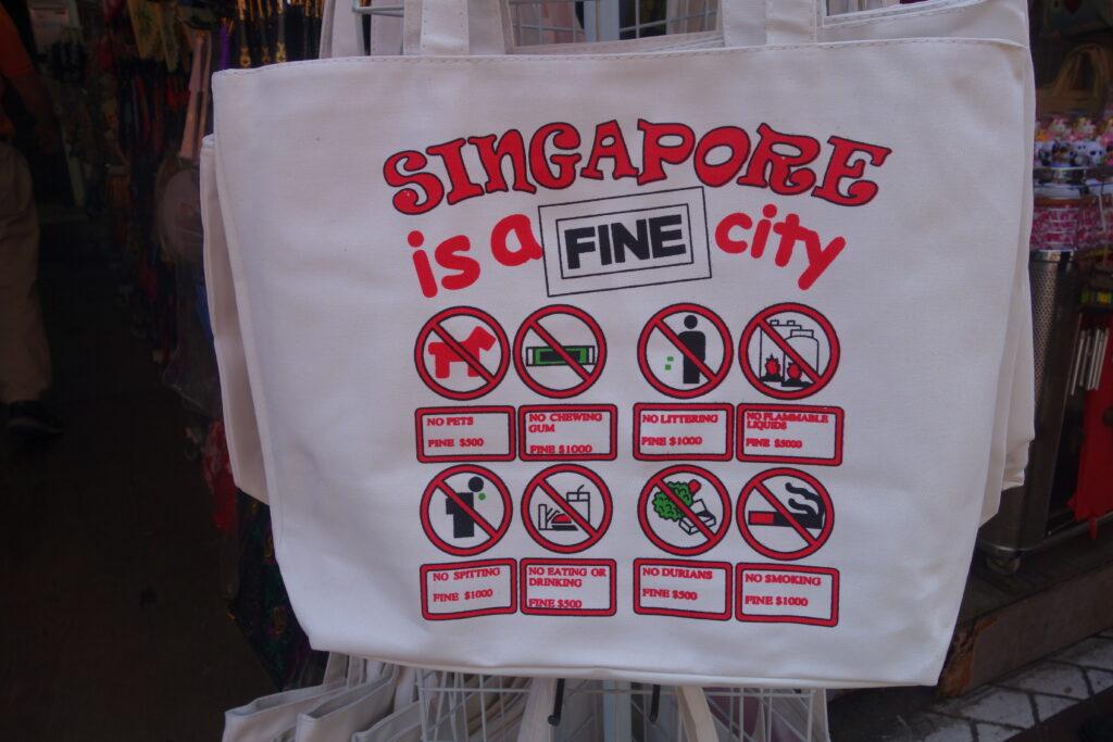 Street vendors capitalizing on Singapore's laws.