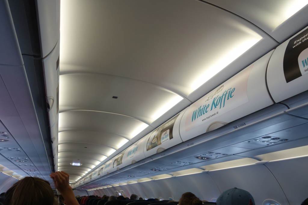 Our Malaysian airline was walpapered with advertisements for white coffee.