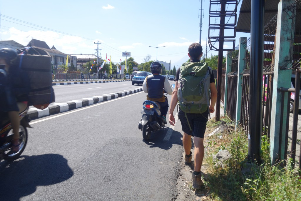 Walking along the side of the road in Jogjakarta because there is no sidewalk.