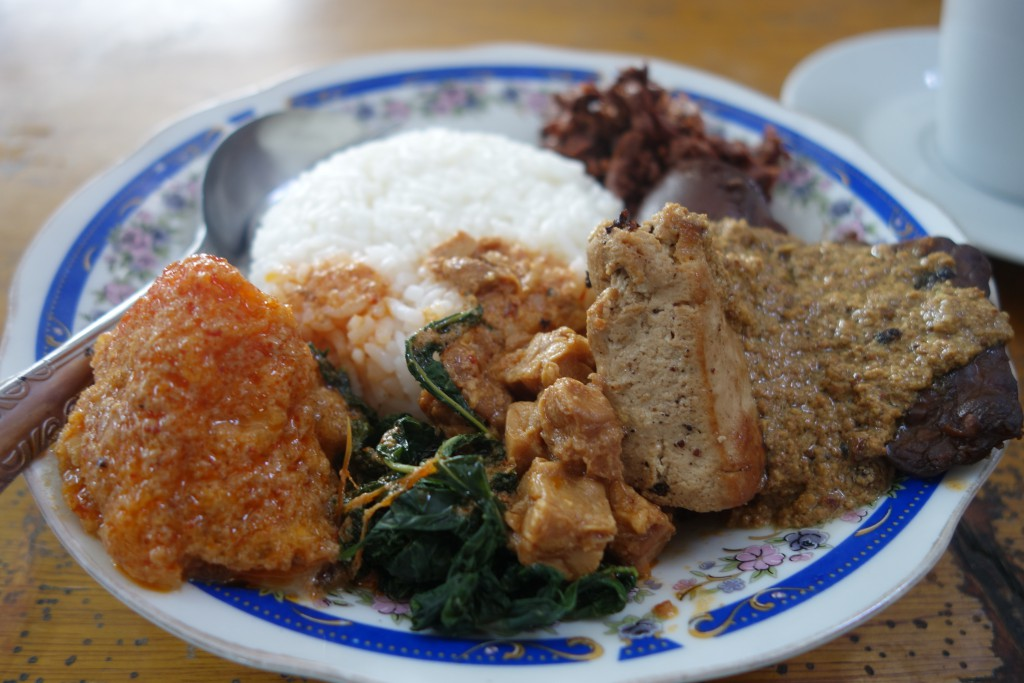 Indonesian gudeg - the orange blob on the left is fried buffalo skin.