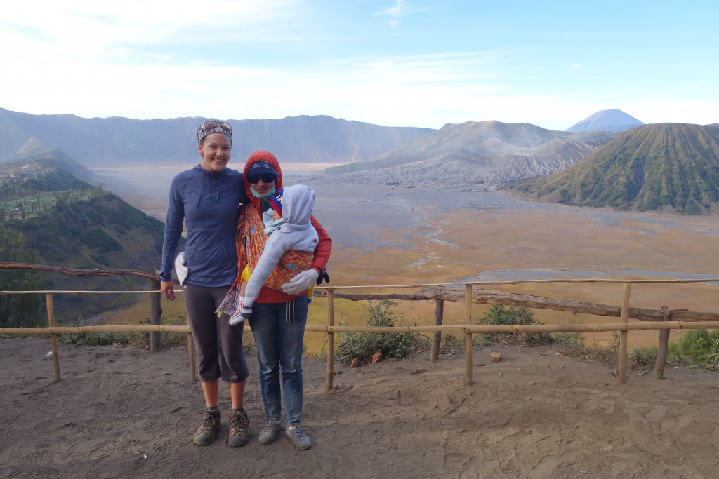 A woman poses with me at the Bromo lookout point. Notice her batik cloth baby carrier! Side note: she asked to take a photo with me --because of my white skin.