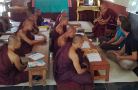 We chat with the monks in order to practice English.